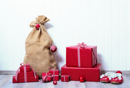 christmas presents: Christmas presents gifts in red paper with checked ribbon on white wooden background.