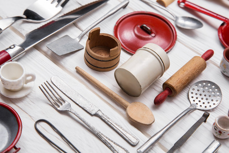 gastronomy: Old red white dolls kitchen miniatures of tin and wood for restaurants and parties.