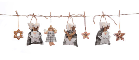 christmasy: Isolated grey, white and orange isolated hanging christmas decoration with gifts, stars and angels.