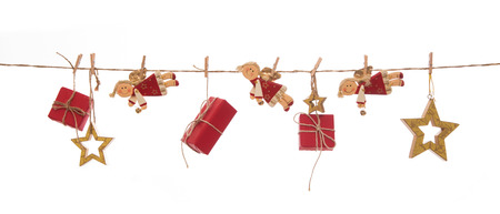 christmasy: Isolated hanging red christmas gift boxes, angels and golden stars on white background for decoration.