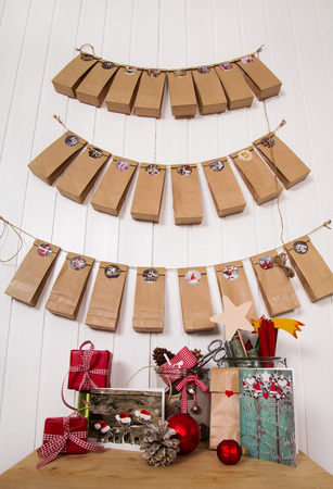 tinkered: Handmade christmas presents. Hanging advent calendar, greeting cards and craft supplies for xmas in red, white, brown and green colors.