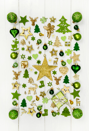 wooden reindeer: Festive christmas decoration in light green, white and golden color. Collection of xmas miniatures.