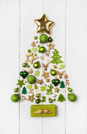 christmas tree: Festive christmas decoration in light green, white and golden color. Collection of xmas miniatures.