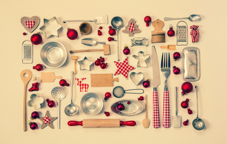 white backing: Old rustic christmas background with a collection of many red checked miniatures of the kitchen for decoration.