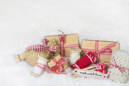 craft material tinker: Handmade christmas presents with sewing utensils in red and white colors. Stock Photo