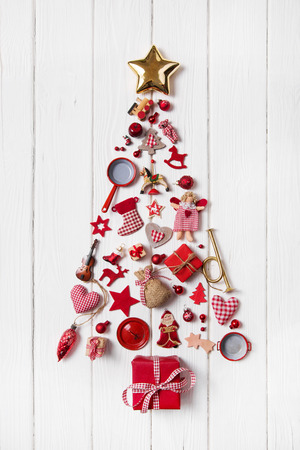 Red checked Christmas tree of a collection of small pieces for decoration.