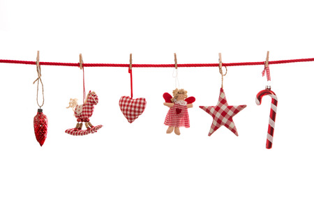 christmas isolated: Hanging red white checkered christmas decoration isolated on the background in country style.