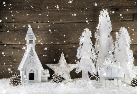 White brown wooden christmas decoration with stars, snowflakes and church.