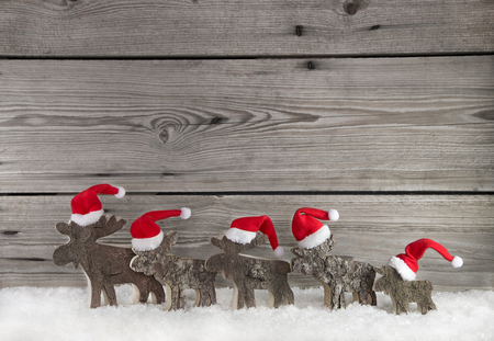 santa moose: Wooden christmas background with a team of santa clause on wood for decoration.