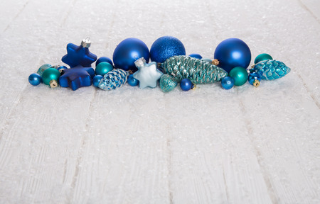 Modern blue, turquoise and white wooden snowy christmas background for advertising.