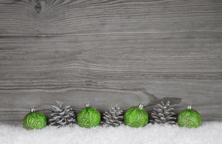 Grey, white and shabby wooden background with christmas decoration.