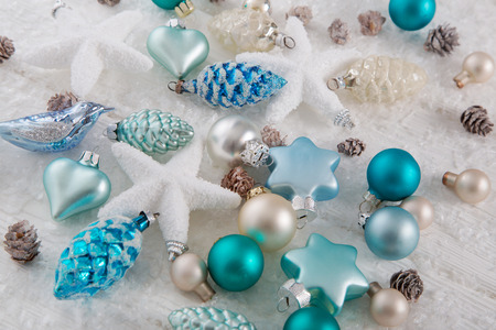 beige background: Modern blue, turquoise, brown and white christmas decoration.