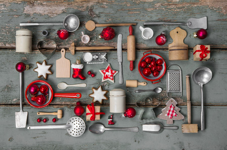 red kitchen: Old children toys of the kitchen. Vintage or country style with nostalgia decoration for Christmas.