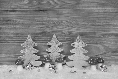 Shabby chic christmas background in grey, white and silver colors with mushrooms, presents and trees for elegant decoration. Imagens