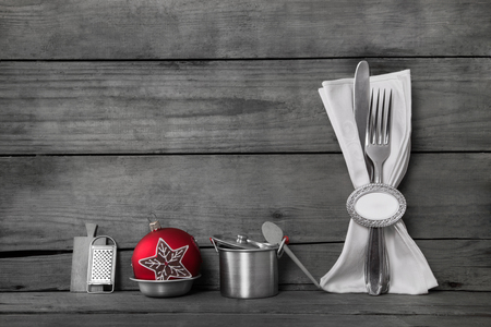 Rustic grey wooden background with kitchen or restaurant decoration for a christmas party.
