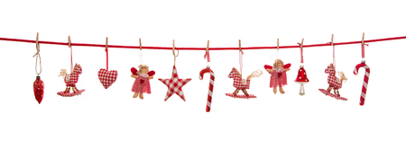 Hanging red white checkered christmas decoration isolated on the background in country style.