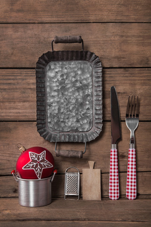 Menu card in red white checked colors with fork and knife for a christmas dinner. Imagens