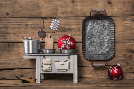 Christmas menu. Wooden background with old utensils for the kitchen.