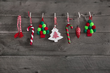 Wooden red green christmas decoration on rustic old background.