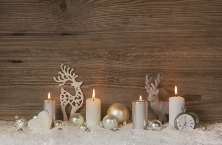 advent candles: Nostalgic golden, brown and white wooden christmas background with four advent candles for christmas decorations. Stock Photo