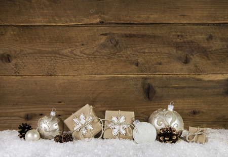 Country style christmas decoration in brown and white colors with gift boxes.