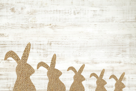 Happy easter greeting card wooden background with bunny for decoration.