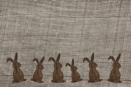 Old wooden background with an easter bunny for decoratios.