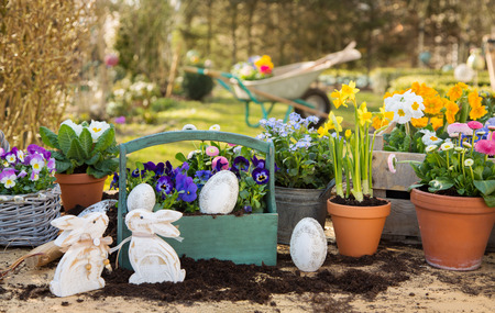 easter flowers: Easter handmade decoration with spring flowers and rabbits at home in the garden. Stock Photo