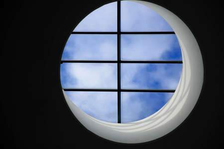 escape from prison: mind, soul and body captured, looking at the blue sky. Stock Photo
