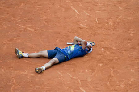 elated: Verdasco on the ground, elated after winning the final at the Barcelona Open final Editorial