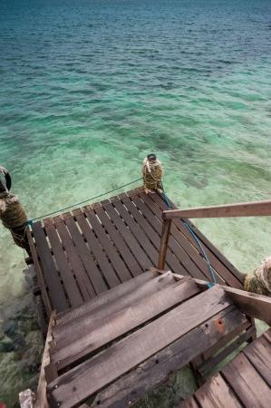 mabul: Steps to blue   green seawater at Mabul Island  Stock Photo