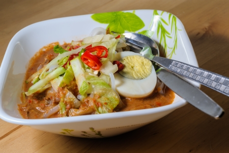 Penang Laksa - Spicy Malaysia Dish in a bowl ready to eat photo