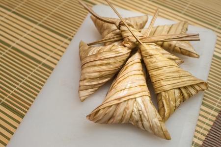 Delicious Ketupat Daun Palas ready to eat on Eid Festival Celebration photo