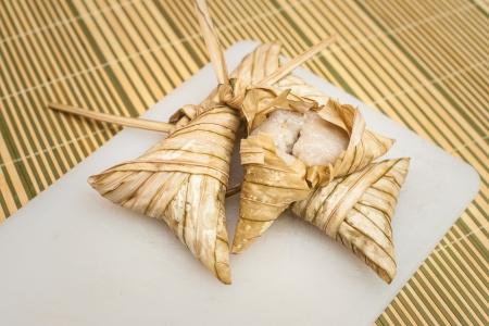 compressed rice: Delicious Ketupat Daun Palas ready to eat on Eid Festival Celebration Stock Photo