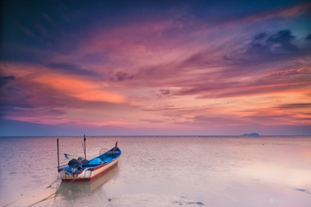 End of the Day - parked fishing boat at sunset