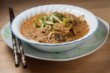 Spicy Johor Laksa in a bowl ready to eat 版權商用圖片