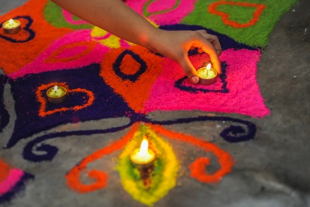 Rangoli, also known as kolam or muggu is a folk art from India  It is usually found during Deepavali and other Indian festivals  Typically consisting of bright colors, rangoli is a decorative design made in living rooms and courtyard floors during Hindu f