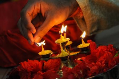 diwali festival of lights , hand lighting an indian oil lamp 스톡 콘텐츠