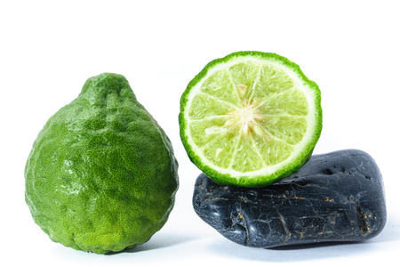 Kaffir Lime on Zen Stone, health and spa concept photo