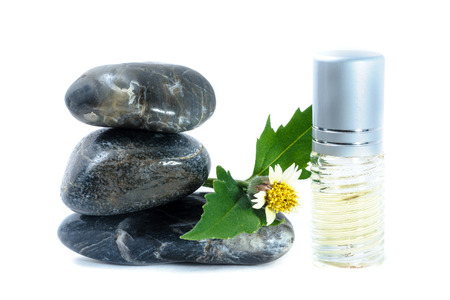 Generic Perfume and Sun Flower on zen stone, white background photo