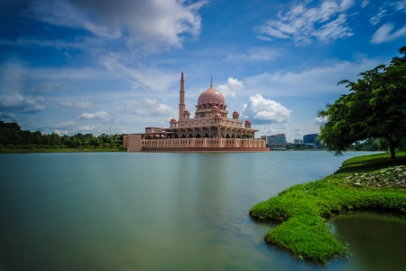 Putrajaya Mosque and its reflection on a calm lake  photo