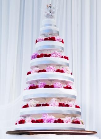 tier: Multi Tier Big Wedding Cake decorated with fresh flowers Stock Photo