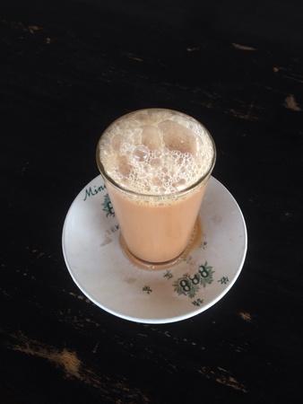 tarik: Teh tarik, a Malaysian cup of tea Stock Photo