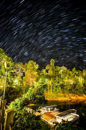 star trail: Star Trail at Royal Belum Rainforest Resort Jetty Stock Photo