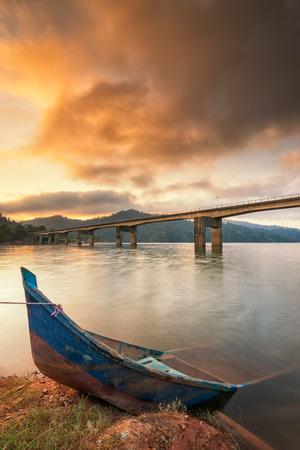 banding: Sunrise at Banding Island and an abandoned boat
