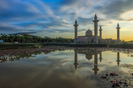islamic scenery: Reflection of a Moque in the morning after sunrise Stock Photo