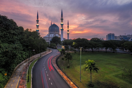 shah: The beautiful Sultan Salahuddin Abdul Aziz Shah Mosque at Sunrise. Also known as the Blue Mosque located at Shah Alam, Selangor, Malaysia Stock Photo