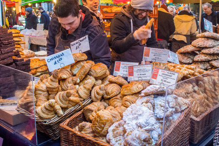 London, UK, 1 February 2014 - Stall selling assortment of pastries at Borough Market.
