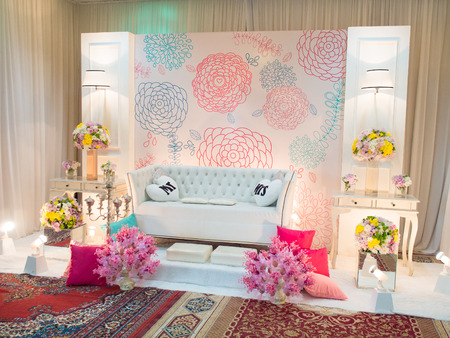 dais: A beautifully English Theme decorated Wedding Altar on a stage at a wedding function. Stock Photo