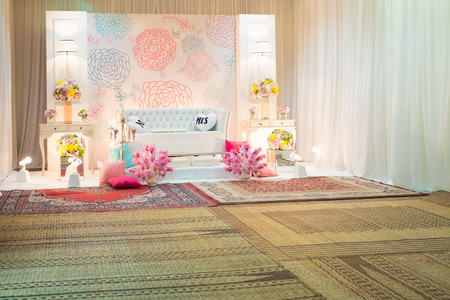 A beautifully English Theme decorated Wedding Altar on a stage at a wedding function. Stock Photo